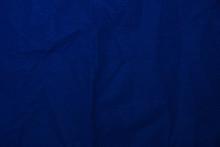 Velvet Matte Crumpled Texture, Dark Blue Corduroy Fabric Background Close-up.