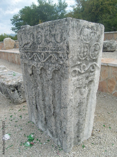 Obraz na plátně Medieval tombstone Stecak with spiral carvings and colonnades Niksic Montenegro