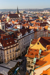 Fototapeta na wymiar city views Prague autumn. Old Town Square. Tiled roofs. View from above.