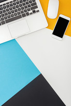 Top View Of Laptop, Smartphone, Computer Mouse On Abstract Geometric Background