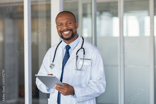 Portrait of happy african doctor at private clinic Wallpaper Mural