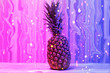 Leinwanddruck Bild - Pineapple in neon pink and blue, in sequins on the table.