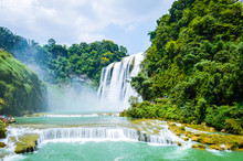 Famous Huangguoshu Waterfall From China Guizhou In Summer. It Is One Of The Largest Waterfalls In China And East Asia.