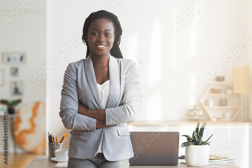 Successful Afro Businesswoman Posing In Office With Arms Crossed Canvas Print