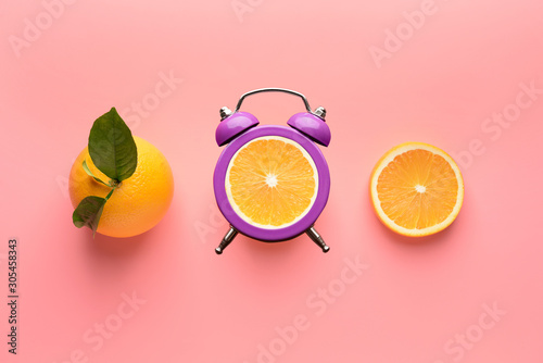 Ripe orange and slices on color background - 305458343