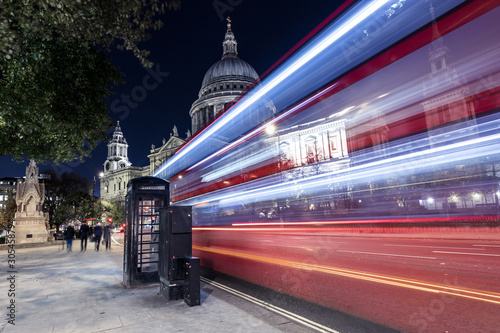 Red bus city traffic at night, St Pauls Cathedral, London