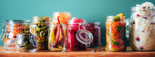 Probiotics Food Background. Korean Carrot, Kimchi, Beetroot, Sauerkraut, Pickled Cucumbers In Glass Jars. Winter Fermented And Canning Food Concept. Banner With Copy Space