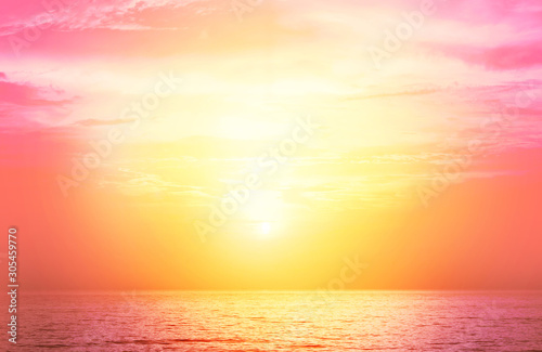 Foto auf AluDibond Koralle Image of the ocean in summer time. Beautiful sunset or sunrise sky over the sea at tropical beach in Living Coral color. Background or copy space for Valentine's day concept.