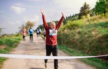 Senior Man Runner Crossing Fin...