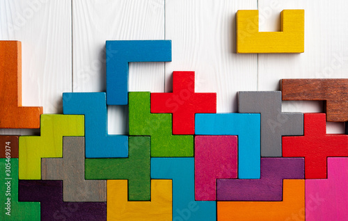 Cuadros en Lienzo Top view on colorful wooden blocks folding on white wooden background
