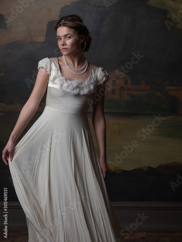 Beautiful young woman in a white long dress in the style of the 19th century Poster Mural XXL