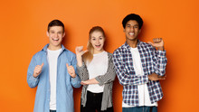 Diverse Classmates Pointing Fingers At Themselves, Posing To Camera