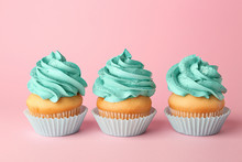 Tasty Cupcakes On Color Backgr...