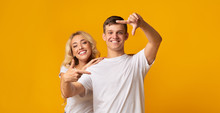 Cheerful Millennial Couple Making Frame With Fingers, Having Fun Together
