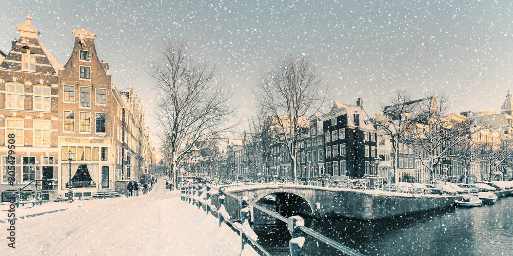 Winter snow view of a Dutch canal in Amsterdam