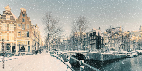 Winter snow view of a Dutch canal in Amsterdam Canvas Print