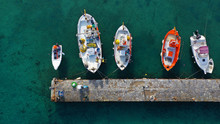 Aerial Drone Photo Of Traditional Wooden Fishing Boat In Old Port Of Mykonos Island,  Cyclades, Greece