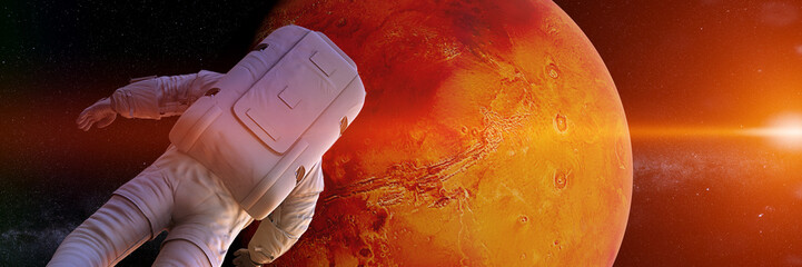 astronaut watching the sunrise during a space walk in orbit of planet Mars (3d science render banner)