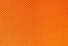 Closeup Of Orange Textile For Background