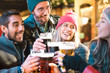 canvas print picture - Friends drinking beer at brewery bar outdoor on winter time - Friendship concept with young people having fun together toasting at happy hour promotion - Focus on girl with pink hat - Warm neon filter