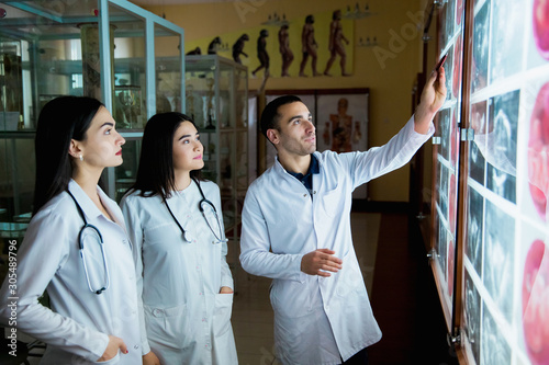 A group of surgeon interns is studying fetal development at different stages of pregnancy Fototapeta