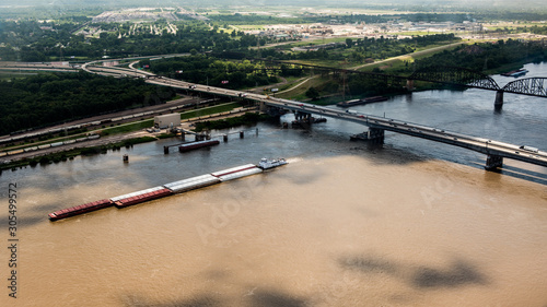 A barge transports freight down the Mississippi River Obraz na płótnie