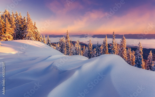 Foto auf Leinwand Lachs Scenic Image at winter mountains during sunset. Awesome Alpine highland with colorful sky over the wintry landscape. Amazing Winter view at snowcovered valley. Wonderful Nature Background.
