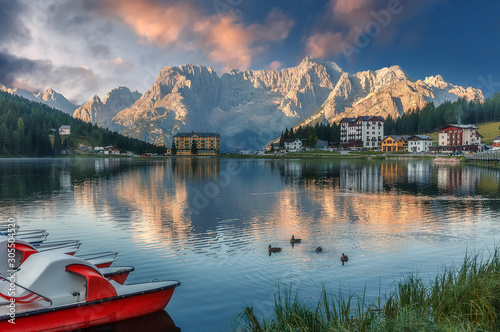 Foto auf AluDibond Blaue Nacht Misurina Lake in the Dolomites mountains in Italy near Auronzo di Cadore during sunset. Fantastic Sunrise over Misurina Lake with Dramatic Colorful sky. Amazing Nature Landscape. Beautiful world