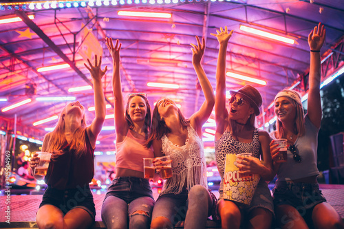 Female friends having fun at the festival - 305504969