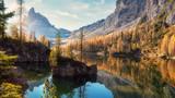 Fototapeta Fototapety na ścianę - Amazing Federa lake, natural Scenery, during Sunrise. Awesome Landscape. Foggy Dolomites Alps with forest under sunlight. Travel in nature. Beautiful sunrise with Lake and majestic Mountains.
