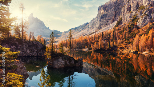 Recess Fitting Deep brown Amazing Federa lake, natural Scenery, during Sunrise. Awesome Landscape. Foggy Dolomites Alps with forest under sunlight. Travel in nature. Beautiful sunrise with Lake and majestic Mountains
