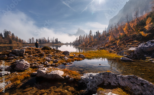 Wall mural - Amazing Scenery of nature with sunlight. Magical Mountain lake Federa at Dolomites Alps glowing sunlit. Wonderful picturesque Scene at Autumn Highlands. Postcard. Awesome Sunny Landscape