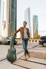 Man With Guitar In The City, M...