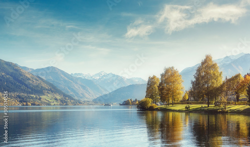Wall mural - wonderlust view of highland lake With autumn trees under sunlight