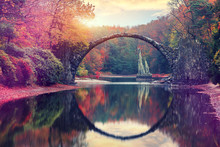 Awesome Autumn Landscape. Amazing Sunset In Azalea And Rhododendron Park Kromlau. Rakotz Bridge, Rakotzbrucke Devil's Bridge In Kromlau, Saxony, Germany. Creative Artistic Image.