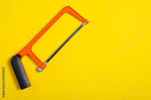 Obraz na plátně hacksaw work hand tool on yellow background, top view, space for text