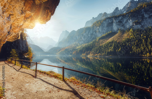 Wall mural - Wonderful Sunny Landscape at Vorderer Gosausee lake in Austrian Alps. Awesome alpine highlands at sunset. Fairy autumn scene in Alpine highland.  Picturesque view of nature. amazing natural Background