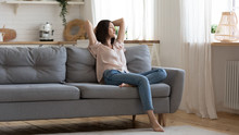Serene Lady Lounge On Sofa Feel Fatigue Napping At Home