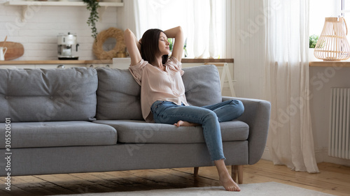 Cuadros en Lienzo Serene lady lounge on sofa feel fatigue napping at home