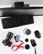 Top view of photographer workplace. Desk top view. Photo camera with big macro lens and photo equipment. Flat lay view