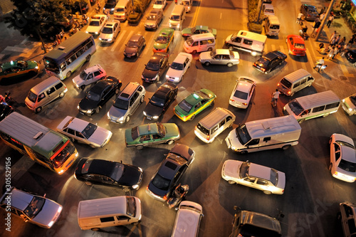 Messy traffic at crossroad at night, aerial view