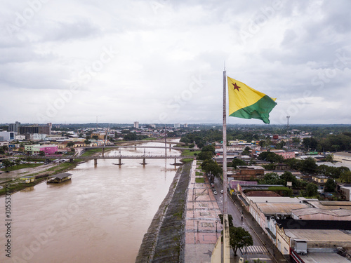 Aerial drone view of Acre river and flag in the amazon Canvas Print