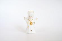 Ceramic Angel Figurine On A Wh...