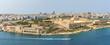 A small boat passes Fort Manoel & Lazzaretto on Manoel Island, Malta