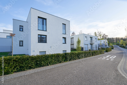Fotomural A street with new residential buildings and a speed limit of 30 kilometers or mi