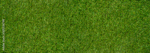 Tuinposter Groene Green wall and green background of artificial grass designed for outdoor sports.