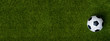 Leinwandbild Motiv Closeup of soccer ball on green grass