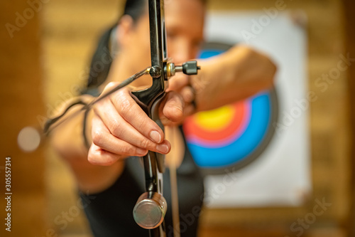 sports archery at the shooting range, competition for the most points to win the cup - 305557314