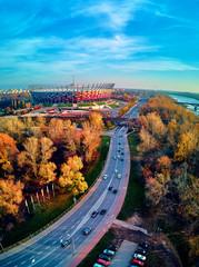 Panel Szklany Podświetlane Warszawa Beautiful sunset panoramic aerial drone view to panorama of Warsaw modern City with skyscraper and The PGE Narodowy National Stadium (Polish: Stadion Narodowy)