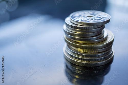 Fototapeta Close-up of stack of coins on dark background. Norwegian Kroner coins. Economy of Norway. obraz